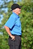 Allvarlig manlig golfare med Golf Club royaltyfria foton