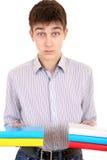 Allvarlig student med böckerna Royaltyfri Fotografi
