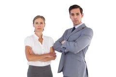 Allvarliga Co-arbetare som tillsammans står Royaltyfri Bild