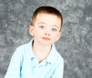 allvarligt barn för pojkeframsidahandome Royaltyfri Fotografi