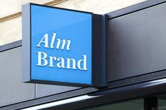 Alm Brand logo on a wall. Copenhagen, Denmark - August 28, 2018: Alm Brand logo on a wall. Alm Brand a Danish financial services group operating within the stock images