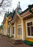 Alma Ata - Huis van stoffen kyzyl-Tan Stock Foto's