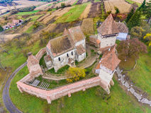 Alma Vii saxon fortified Church in Transylvania, Romania. Artist. Ic HDR image. Aerial view from a drone Stock Photo