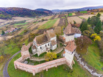Alma Vii saxon fortified Church in Transylvania, Romania. Artist. Ic HDR image. Aerial view from a drone Royalty Free Stock Photography