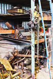 Almacén de la fábrica con los recambios usados Imagen de archivo libre de regalías