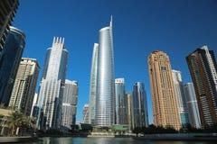 Almas tower and Jumeirah Lakes Towers, Dubai Multi Commodities Centre, UAE. UAE, DUBAI, FEBRUARY 5, 2016: Almas Tower supertall skyscraper and Jumeirah Lakes stock photos