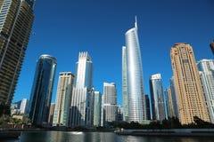 Almas tower and Jumeirah Lakes Towers, Dubai Multi Commodities Centre, UAE. UAE, DUBAI, FEBRUARY 5, 2016: Almas Tower supertall skyscraper and Jumeirah Lakes royalty free stock images