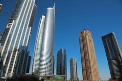 Almas tower and Jumeirah Lakes Towers, Dubai Multi Commodities Centre, UAE. UAE, DUBAI, FEBRUARY 5, 2016: Almas Tower supertall skyscraper and Jumeirah Lakes stock images