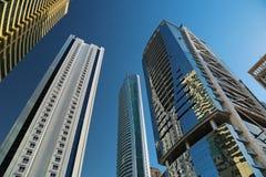 Almas tower and Jumeirah Lakes Towers, Dubai Multi Commodities Centre, UAE. UAE, DUBAI, FEBRUARY 5, 2016: Almas Tower supertall skyscraper and Jumeirah Lakes stock photo