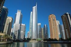 Almas tower and Jumeirah Lakes Towers, Dubai Multi Commodities Centre, UAE. UAE, DUBAI, FEBRUARY 5, 2016: Almas Tower supertall skyscraper and Jumeirah Lakes royalty free stock photo