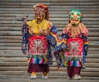 Almaty Buddha Temple monks deity mask monster feast Royalty Free Stock Image