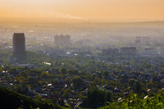 Almaty city in the fog in sunset with smog and dust in the air, Royalty Free Stock Image