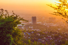 Almaty city in the fog in sunset with smog and dust in the air Kazakhstan. Royalty Free Stock Images