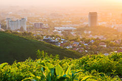 Almaty city in the fog in sunset with smog and dust in the air Kazakhstan. Stock Images
