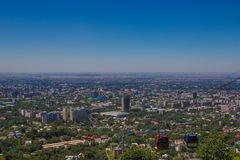 Almaty city view from Koktobe hill and cabin of cable car, Kazak Stock Photography