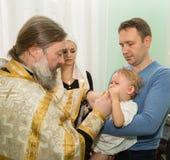 ALMATY, IL KAZAKISTAN - 17 DICEMBRE: Cerimonia di battesimo il 17 dicembre 2013 a Almaty, il Kazakistan. Immagini Stock