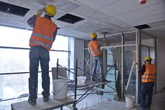 Free Almaty, Kazakhstan - 11.03.2015 : Workers Carry Out Repair And Construction Work In The Building Stock Image - 219177731