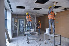 Free Almaty, Kazakhstan - 11.03.2015 : Workers Carry Out Repair And Construction Work In The Building Stock Photos - 219177733