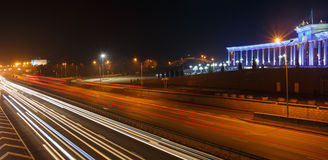 ALMATY, KAZAKHSTAN - February 24, 2016: Evening view of the Almaty city. Park of first president. Light trails on motorway highway Stock Images