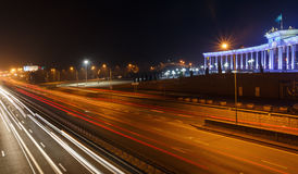 ALMATY, KAZAKHSTAN - February 24, 2016: Evening view of the Almaty city. Park of first president. Light trails on motorway highway Royalty Free Stock Photography