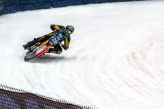 Motorcycle racing in a sharp bend on the ice. Almaty , Kazakhstan - February 15, 2015. Motorcycle racing in a sharp bend on the ice. International competitions royalty free stock photo