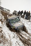 Almaty, Kazakhstan - February 21, 2013. Off-road racing on jeeps, Car competition,  ATV. Traditional race. Kaskelen gullies Cup  the Republic of Kazakhstan Royalty Free Stock Photography
