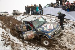 Almaty, Kazakhstan - February 21, 2013. Off-road racing on jeeps, Car competition,  ATV. Traditional race. Kaskelen gullies Cup  the Republic of Kazakhstan Royalty Free Stock Photo