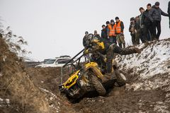 Almaty, Kazakhstan - February 21, 2013. Off-road racing on jeeps, Car competition,  ATV. Traditional race. Kaskelen gullies Cup  the Republic of Kazakhstan Royalty Free Stock Images