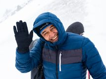 ALMATY KAZAKHSTAN - FEBRUARY 03 2019: portrait of an unknown man in a snow blizzard during the Alpine Race competition. In the mountains in winter. February 02 royalty free stock photography