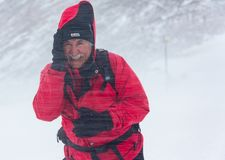 ALMATY KAZAKHSTAN - FEBRUARY 03 2019: portrait of an unknown man in a snow blizzard during the Alpine Race competition. In the mountains in winter. February 02 royalty free stock images