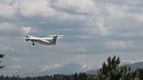 Bombardier airplane takeoff against scenic mountains stock video