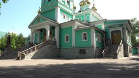 Almaty Orthodox cathedral. Almaty Green Colored Russian Orthodox Christian Cathedral of Saint Nicholas Side view on a sunny blue sky day stock footage