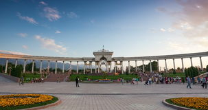 Almaty park time lapse. ALMATY, KAZAKHSTAN JULY 3, 2015 People walking near entrance of dendra park of first president Nursultan Nazarbayev with arches and stock footage