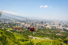 Almaty skyline with cable car Royalty Free Stock Photo