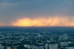 Almaty Skyline during a Sunset Rain, Kazakhstan in August 2018 t stock image