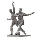Almaty - vecchia scultura dei giocatori di football americano - isolata Fotografia Stock