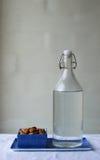 Almendras y botella de cristal Imagenes de archivo