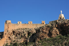 Almeria castle. Alcazaba - fortified Moorish castle on a hill in Almeria, Andalusia, Spain. Christ statue Stock Images