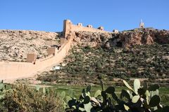 Almeria castle. Alcazaba - fortified Moorish castle on a hill in Almeria, Andalusia, Spain. Christ statue Royalty Free Stock Photography