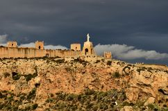 Defensive wall and stormy clouds Almeria Spain royalty free stock photography