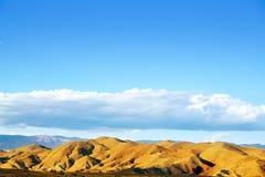 Almeria Tabernas desert mountains in Spain. Blue sky day Stock Photos