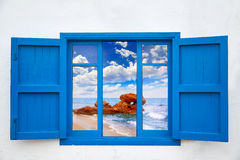Almeria view from blue window of Mojacar beach Stock Images