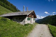 Almhuette. Innere Alm (Sesvennagruppe) mountain landscape Royalty Free Stock Photo