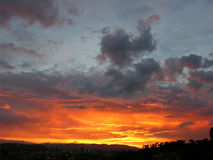 Almighty and powerful fire in the sky over the city and mountais - unretouched Royalty Free Stock Photo