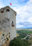 Almodovar castle over the fertile valley of river Guadalquivir. An ancient castle dominates above the green valley. Flags are flapping in the wind on the high stock photos