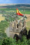 Almodovar castle over the fertile valley of river Guadalquivir. An ancient castle dominates the green areas in the Spanish municipality of Almodovar del Rio stock photo