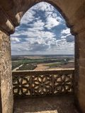 Ogival Arch of balcony in a tower, landscape of Cordoba countrys. Almodovar del Rio, Cordoba, Spain - June 9, 2018: Ogival Arch of balcony in a tower, landscape Stock Photo
