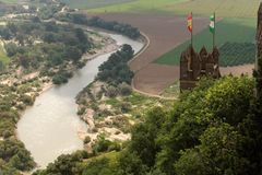 Almodovar Del Rio medieval castle with flags of Spain and Andalusia above Guadalquivir river. Bend royalty free stock image