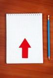 Almofada de escrita na tabela Imagens de Stock