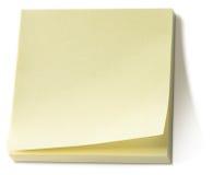 Almofada de memorando pegajosa amarela da nota de post-it   Fotos de Stock